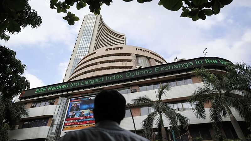 Sensex, Nifty trade flat at noon; pharma, auto stocks among major gainers