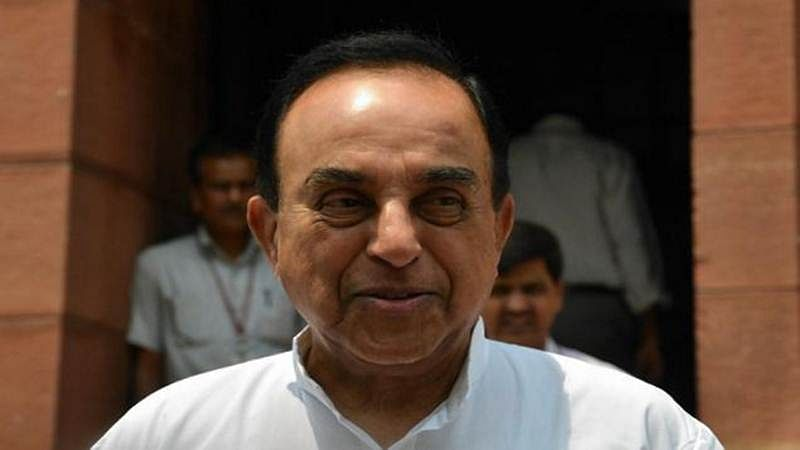 Jaitley, A Subramanian and Das sitting idle to tackle currency crunch: Swamy