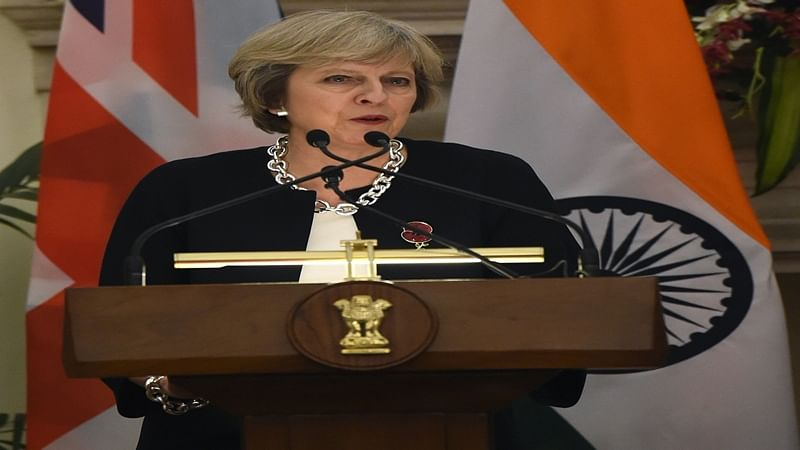 Britain's Prime Minister Theresa May speaks next to India's Prime Minister Narendra Modi (R) at a press conference during an agreement signing ceremony in New Delhi on November 7, 2016. Prime Minister Theresa May said Britain would become the ultimate free trade champion as she laid the groundwork on November 7 for a potential post-Brexit deal with India, the world's fastest growing major economy.  / AFP PHOTO / PRAKASH SINGH