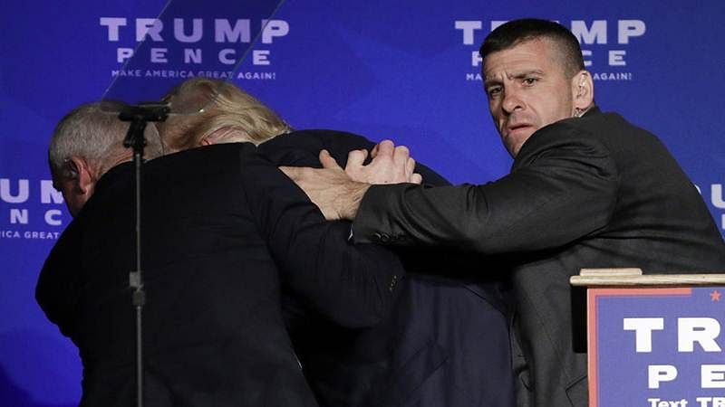 Donald Trump whisked off stage by secret service men in false gun scare