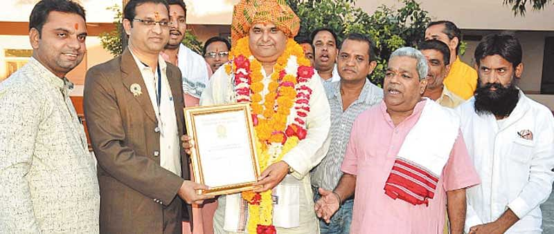 City priest registers name in Golden Book of World Records