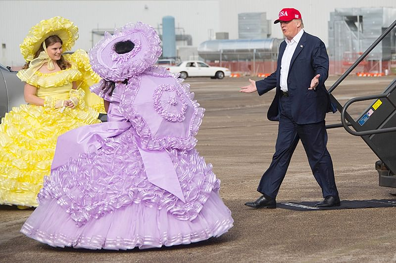 US President-elect Donald Trump greets members of the Azalea Trail Maids as he arrives in Mobile, Alabama, for a 'Thank You Tour 2016' rally on December 17, 2016. / AFP PHOTO / JIM WATSON