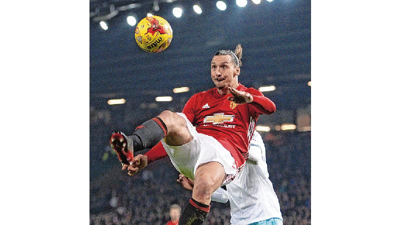 ManU through, Arsenal crash