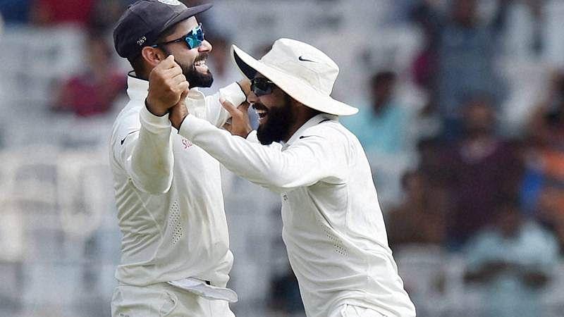 Chennai: India's captain Virat Kohli and Ravindra Jadeja celebrates the dismissal of England's Moeen Ali, during their second day of the fifth cricket test match at MAC Stadium in Chennai on Saturday. PTI Photo by R Senthil Kumar(PTI12_17_2016_000112B)