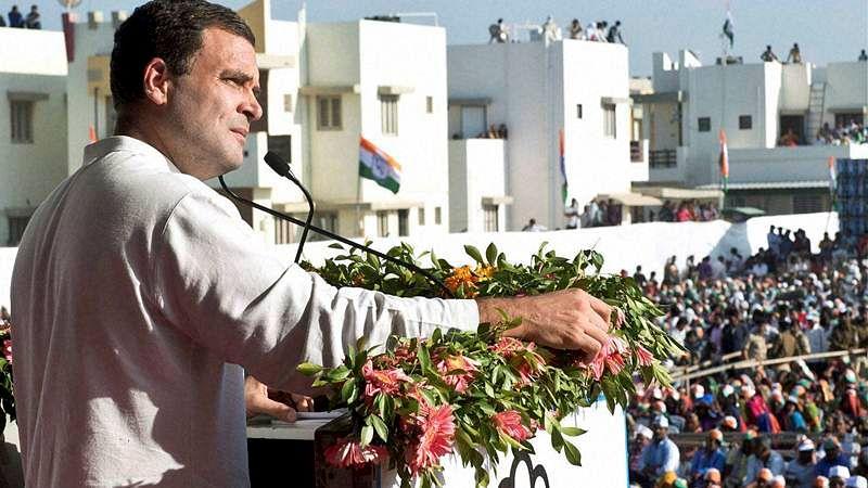 Mehasana:  Congress vice-president Rahul Gandhi addresses a public meeting in Mehsana on Wednesday. PTI Photo   (PTI12_21_2016_000182B)