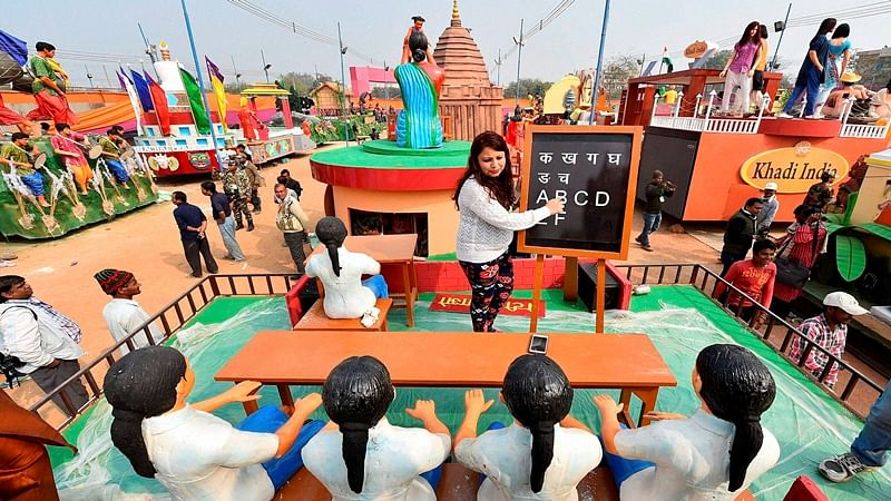 New Delhi: Haryana tableaux artists, participating in the forthcoming Republic Day function, during a press preview in New Delhi on Sunday. PTI Photo by Kamal Singh
