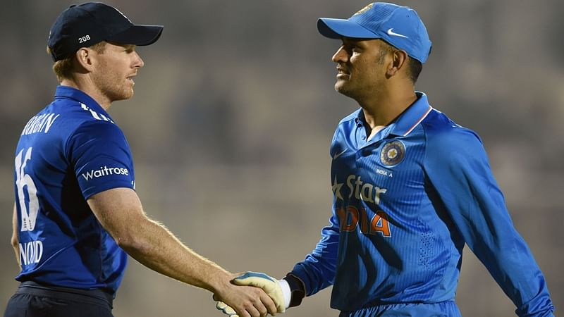 India A captain Mahendra Singh Dhoni (R) shakes hands with England XI captain Eoin Morgan after England XI won the first warm-up one day cricket match against India A at the Cricket Club of India (CCI) stadium in Mumbai on January 10, 2017.