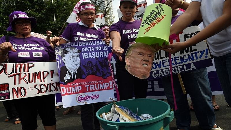 Hundreds of people protests against Donald Trump at US embassy in Manila