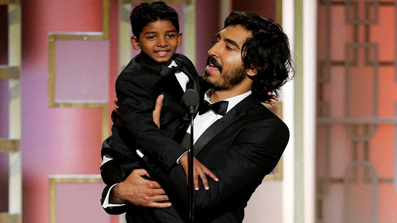Beverly Hills : This image released by NBC shows presenters Sunny Pawar, left, and Dev Patel at the 74th Annual Golden Globe Awards at the Beverly Hilton Hotel in Beverly Hills, Calif., on Sunday, Jan. 8, 2017. AP/PTI(AP1_9_2017_000012B)