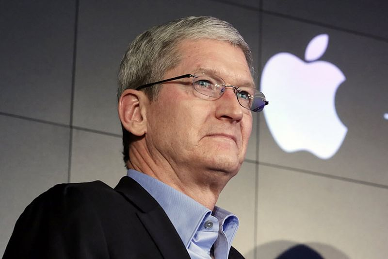 Apple cuts CEO Cook's pay as iPhone sales decline