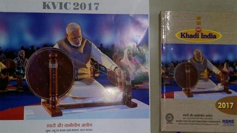 Opposition flays Modi over 'replacing' Gandhi in KVIC calendar, BJP defends