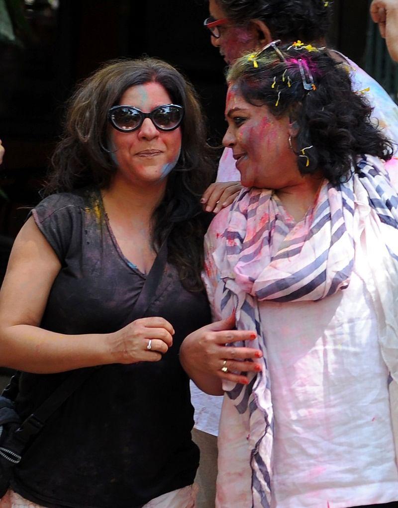 Indian Bollywood film director Zoya Akhtar (L) and actress Tanvi Azmi (R) take part in celebrations to mark the Hindu festival of Holi in Mumbai