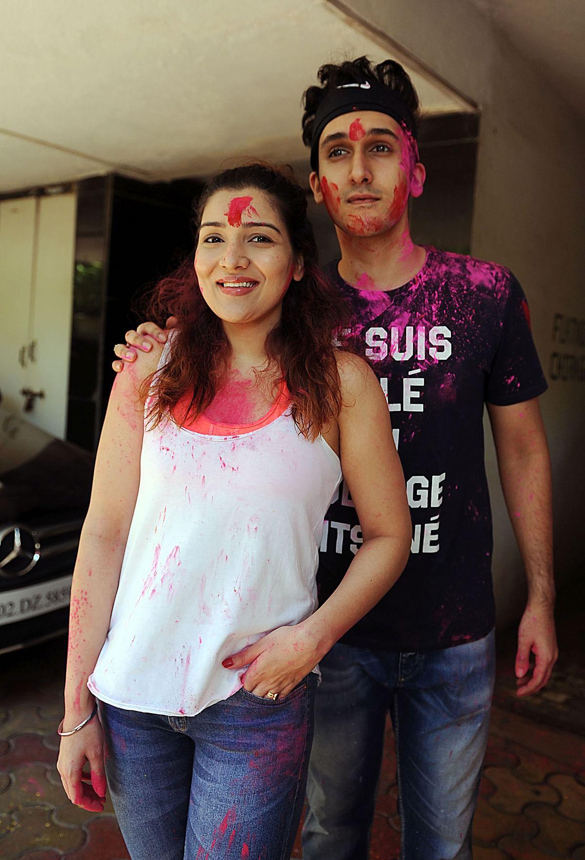 Indian Bollywood actress Tina Ahuja (L) and her brother Yashvardan Ahuja take part in celebrations to mark the Hindu festival of Holi in Mumbai
