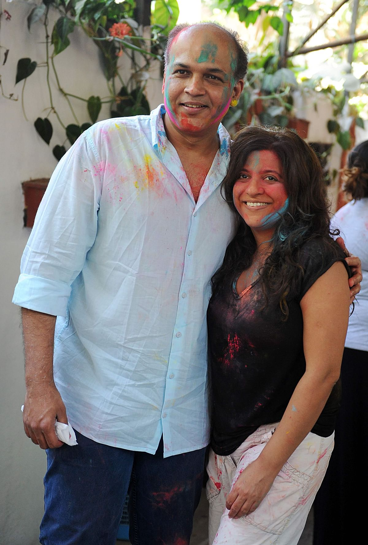 Indian Bollywood film directors Ashutosh Gowariker (L) and Zoya Akhtar (R) take part in celebrations to mark the Hindu festival of Holi in Mumbai