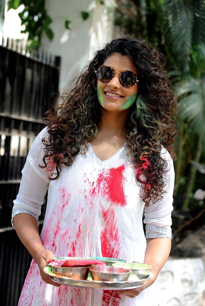 Indian Bollywood actress Saiyami Kher takes part in celebrations to mark the Hindu festival of Holi in Mumbai