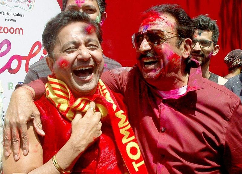 Bollywood actor Gulshan Grover and singer Sukhwinder Singh celebrating Holi Festival in Mumbai on Monday.