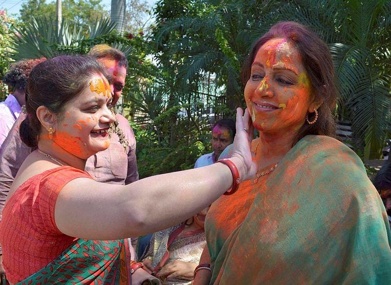 BJP MP and Bollywood actress Hemamalini celebrating Holi festival in Mathura on Monday.