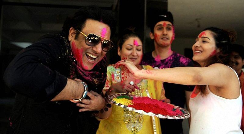 Bollywood actor Govinda with his wife Sunita Ahuja, daughter Tina Ahuja and son Yashvardan celebrating Holi festival in Mumbai on Monday.