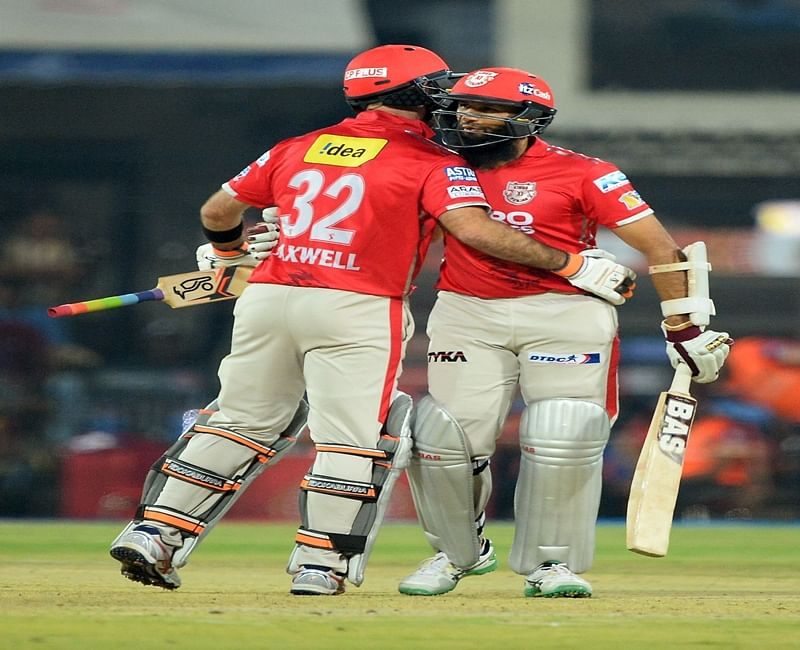 Kings XI Punjab batsman Glenn Maxwell (L) hugs his team batsman Hashim Amla after he completes his half century (50 runs) during the 2017 Indian Premier League (IPL) Twenty20 cricket match between Kings XI Punjab and Royal Challengers Bangalore at the Holkar Stadium in Indore, on April 10, 2017. IMAGE RESTRICTED TO EDITORIAL USE - STRICTLY NO COMMERCIAL USE----- / GETTYOUT / AFP PHOTO / SAJJAD HUSSAIN / ----IMAGE RESTRICTED TO EDITORIAL USE - STRICTLY NO COMMERCIAL USE----- / GETTYOUT