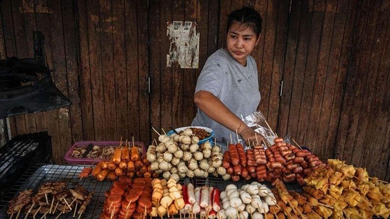 Bangkok's street food riding into sunset