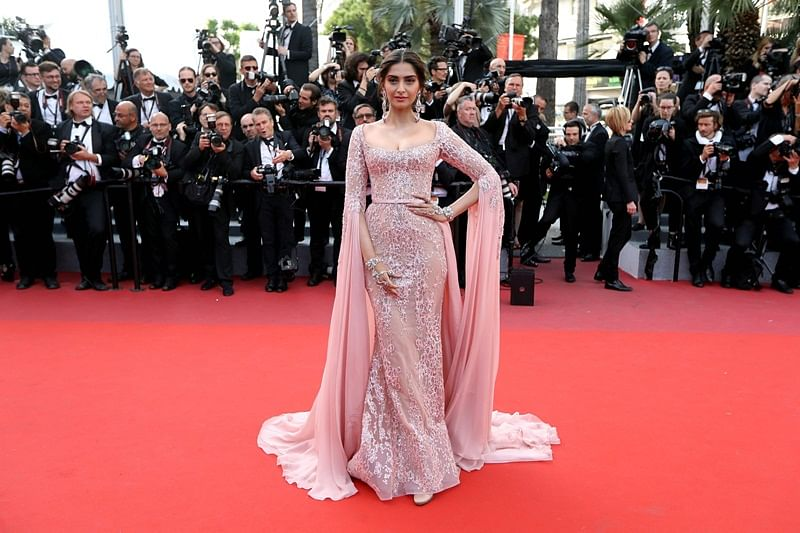 "<span style=""color: #000080;""><em>Indian actress Sonam Kapoor poses as she arrives on May 21, 2017 for the screening of the film 'The Meyerowitz Stories (New and Selected)' at the 70th edition of the Cannes Film Festival in Cannes, southern France.</em></span>"