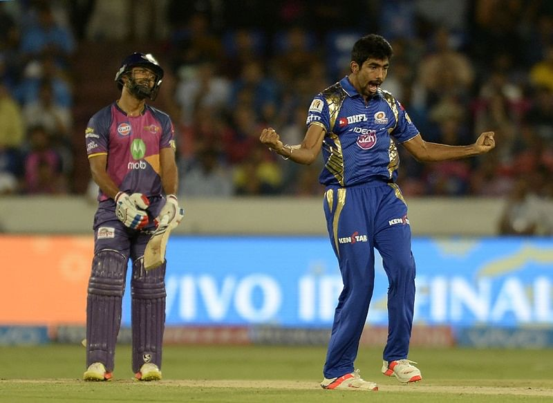 "<em><span style=""color: #333399;"">Mumbai Indians cricketer Jasprit Bumrah (R) celebrates after the dismissal of Rising Pune Supergiant batsman Rahul Tripathi(L) during the 2017 Indian Premier League (IPL) Twenty20 final cricket match between Mumbai Indians and Rising Pune Supergiant at The Rajiv Gandhi International Cricket Stadium in Hyderabad on May 21, 2017.</span></em>"