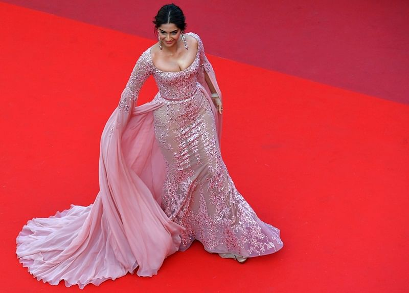 "<em><span style=""color: #000080;"">Indian actress Sonam Kapoor poses as she arrives on May 21, 2017 for the screening of the film 'The Meyerowitz Stories (New and Selected)' at the 70th edition of the Cannes Film Festival in Cannes, southern France.</span></em>"