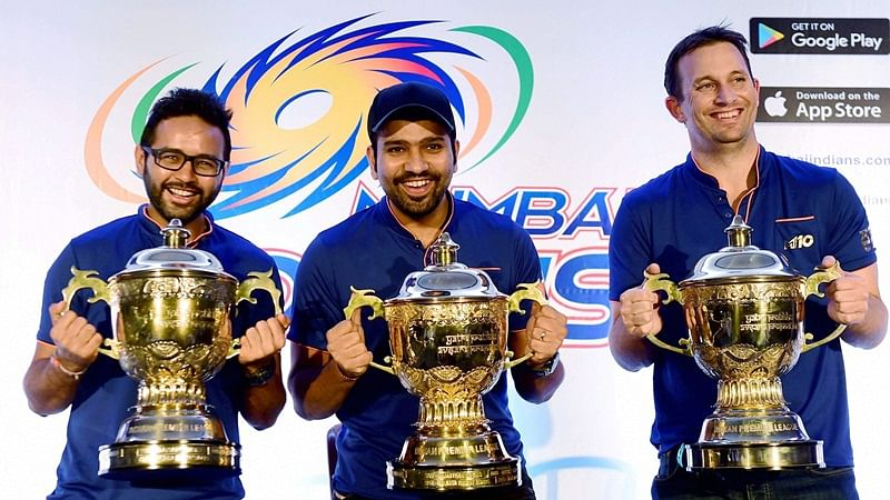 Mumbai Indians captain Rohit Sharma and player Parthiv Patel and Shane Bond pose for media before a press conference