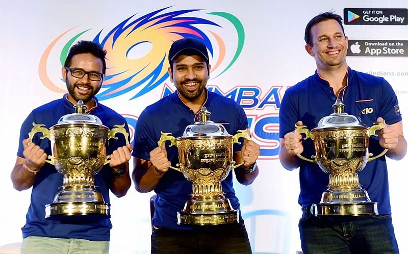 Mumbai: Mumbai Indians captain Rohit Sharma and player Parthiv Patel and Shane Bond pose for media before press conference of their IPL 2017 win, in Mumbai on Monday.