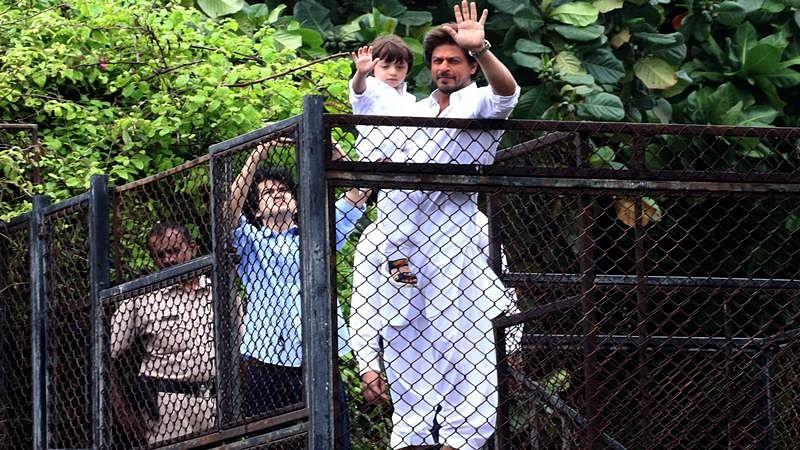 See pics: Shah Rukh Khan, AbRam greet fans outside Mannat on Eid