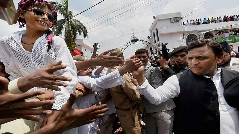 Former UP CM Akhilesh Yadav greeting muslims on the occasion of Eid-ul-Fitr in Lucknow. PTI Photo by Nand kumar