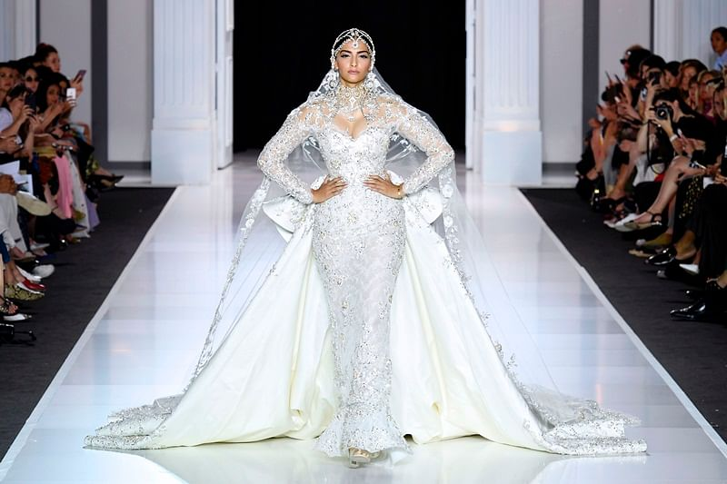 Paris Fashion Week 2017 Pictures: Fashionista Sonam Kapoor stuns in bridal white gown