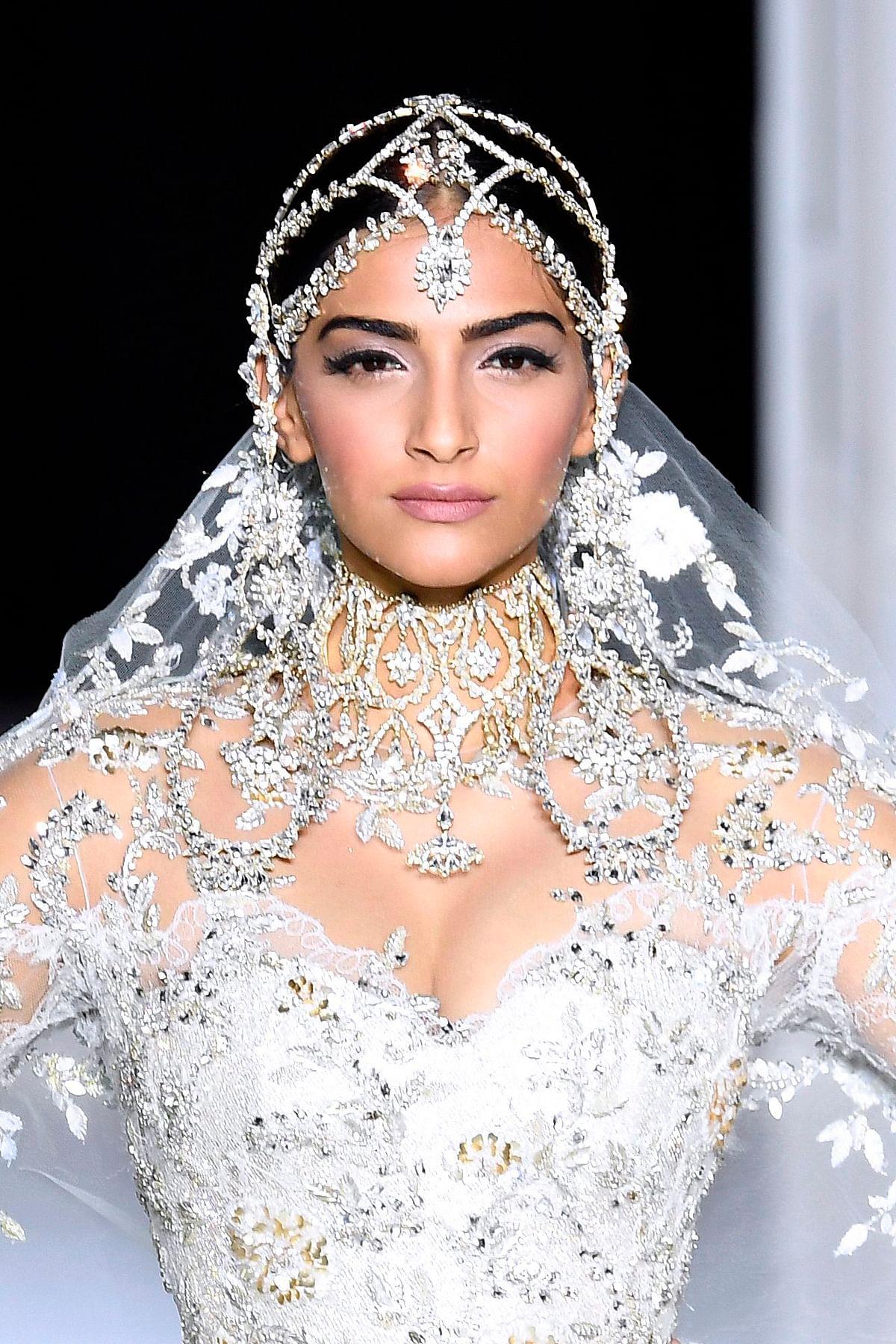 Paris Fashion Week 2017 Pictures: Fashionista Sonam Kapoor stuns in bridal white gown