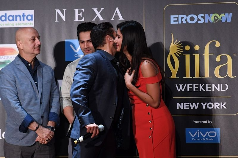 Bollywood actor Salman Khan (C) greets actress Katrina Kaif (R) as Anupam Kher (L) and Varun Dhawan look on during a press conference ahead of the 18th International Indian Film Academy (IIFA) Festival, in New York City July 13, 2017. / AFP PHOTO / ANGELA WEISS
