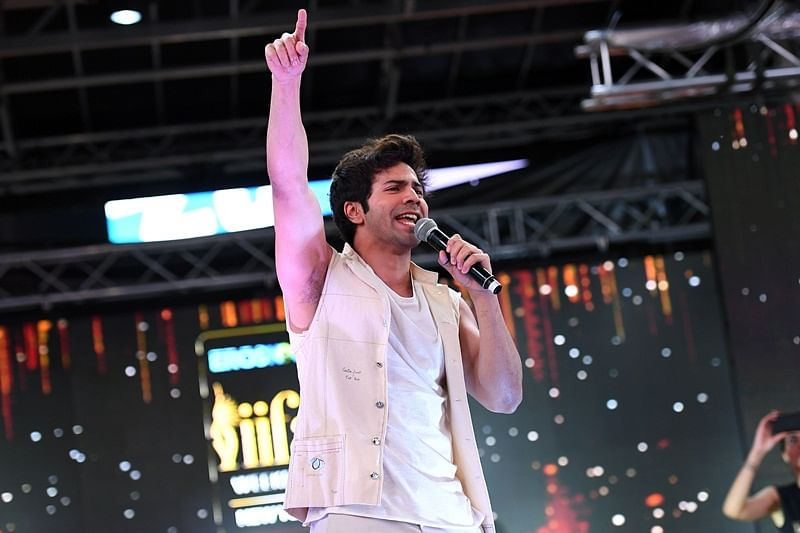 Bollywood actor Varun Dhawan performs during IIFA Stomp in the Times Square on July 13, 2017 to kick off the 18th International Indian Film Academy (IIFA) Festival in New York. / AFP PHOTO / ANGELA WEISS