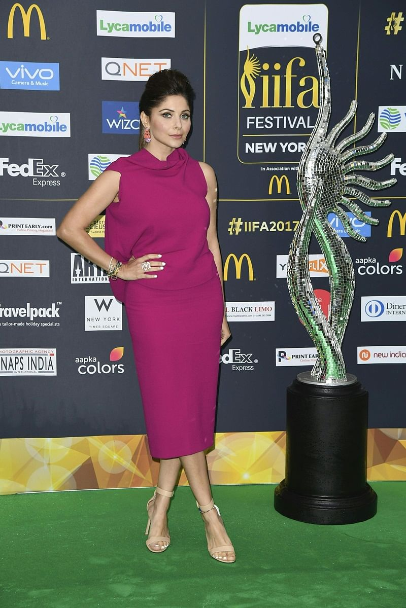 Bollywood singer Kanika Kapoor arrives for IIFA Rocks July 14, 2017 at the MetLife Stadium in East Rutherford, New Jersey during the 18th International Indian Film Academy (IIFA) Festival. / AFP PHOTO / ANGELA WEISS