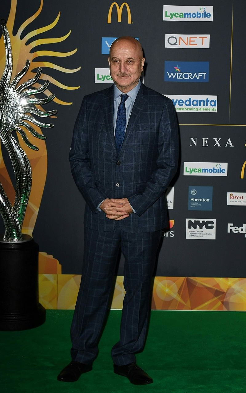Bollywood Actor Anupam Kher arrives for IIFA Rocks July 14, 2017 at the MetLife Stadium in East Rutherford, New Jersey during the 18th International Indian Film Academy (IIFA) Festival. / AFP PHOTO / ANGELA WEISS