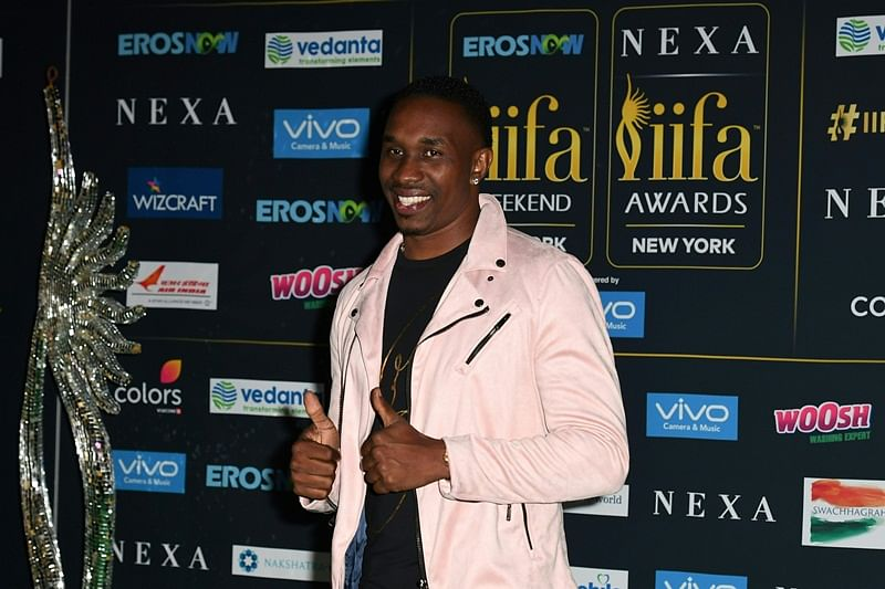 West Indies cricket player Dwayne Bravo arrives for IIFA Rocks July 14, 2017 at the MetLife Stadium in East Rutherford, New Jersey during the 18th International Indian Film Academy (IIFA) Festival. / AFP PHOTO / ANGELA WEISS