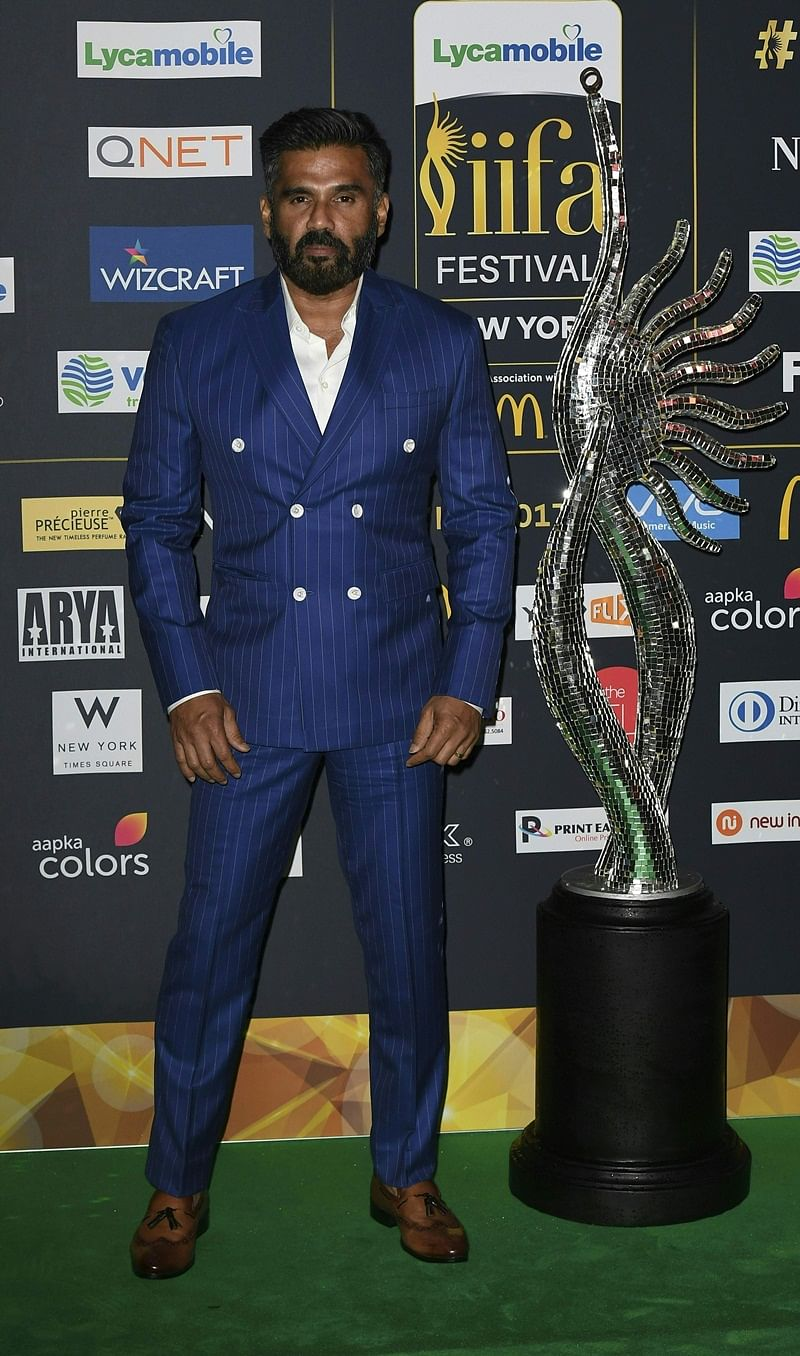 Bollywood Actor Sunil Shetty arrives for IIFA Rocks July 14, 2017 at the MetLife Stadium in East Rutherford, New Jersey during the 18th International Indian Film Academy (IIFA) Festival. / AFP PHOTO / ANGELA WEISS