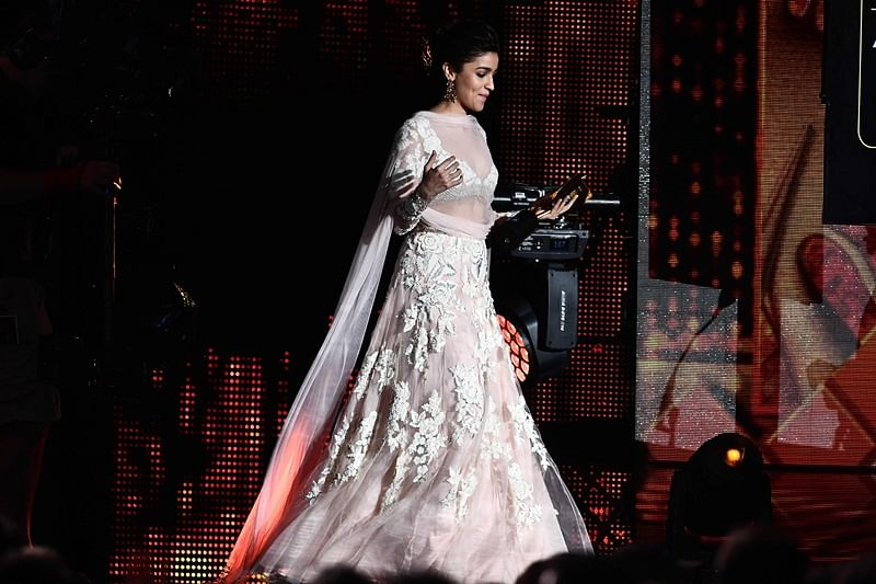 Bollywood actress Alia Bhatt arrives on stage to give an award during IIFA Rocks July 14, 2017 at the MetLife Stadium in East Rutherford, New Jersey during the 18th International Indian Film Academy (IIFA) Festival. / AFP PHOTO / Jewel SAMAD