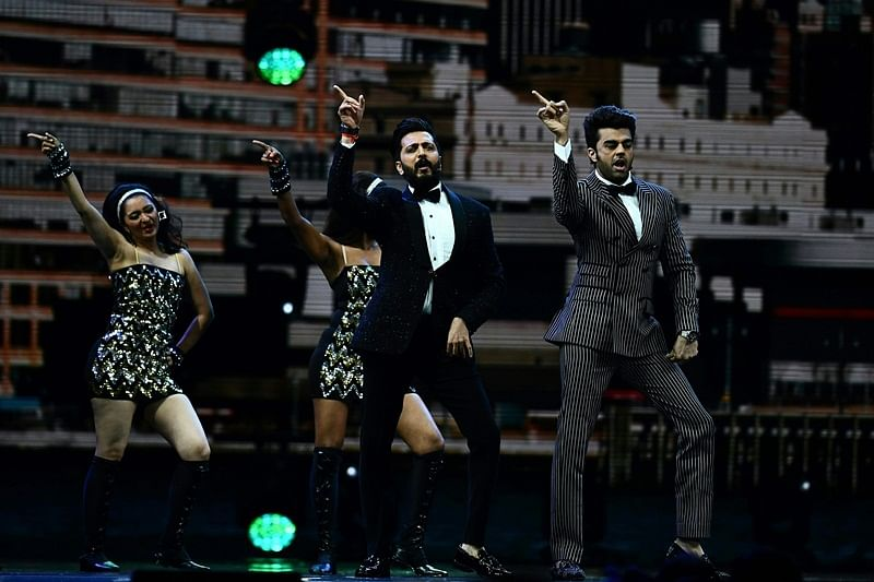 """CORRECTION – Bollywood actor Ritesh Deshmukh (L) and Bollywood actor Manish Paul perform on stage during IIFA Rocks July 14, 2017 at the MetLife Stadium in East Rutherford, New Jersey during the 18th International Indian Film Academy (IIFA) Festival. / AFP PHOTO / Jewel SAMAD / """"The erroneous mention appearing in the metadata of this photo by Jewel SAMAD has been modified in AFP systems in the following manner: [Ritesh Deshmukh] instead of [Hrithik Roshan]. Please immediately remove the erroneous mention from all your online services and delete it from your servers. If you have been authorized by AFP to distribute it to third parties, please ensure that the same actions are carried out by them. Failure to promptly comply with these instructions will entail liability on your part for any continued or post notification usage. Therefore we thank you very much for all your attention and prompt action. We are sorry for the inconvenience this notification may cause and remain at your disposal for any further information you may require."""""""