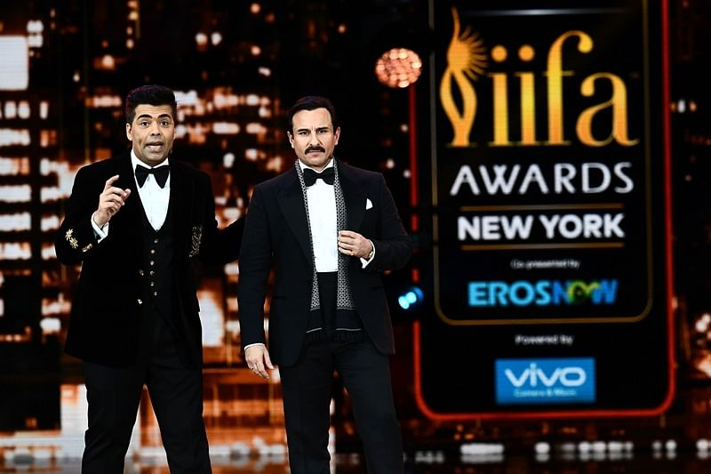 Bollywood actor Saif Ali Khan (R) and director/producer Karan Johar host the IIFA Awards of the 18th International Indian Film Academy (IIFA) Festival at the MetLife Stadium in East Rutherford, New Jersey, on July 15, 2017.