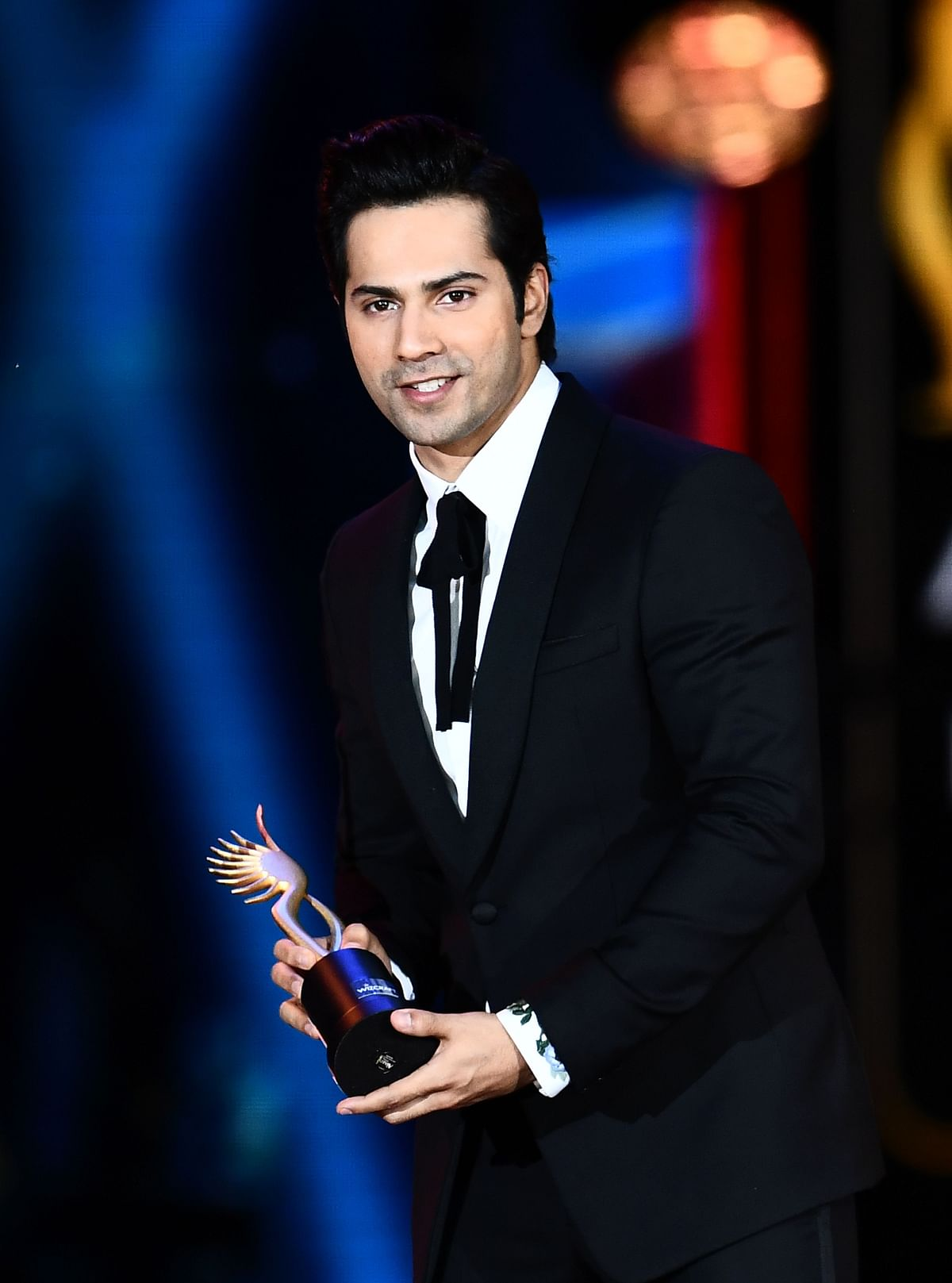 "Winner of Performance in a Comic Role, Varun Dhawan (L) for ""Dishoom"" accepts the award during the 18th International Indian Film Academy (IIFA) Festival at the MetLife Stadium in East Rutherford, New Jersey, on July 15, 2017. / AFP PHOTO / JEWEL SAMAD"
