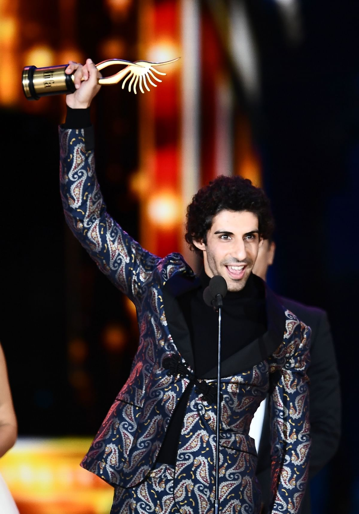 "Winner of Performance in a Negative Role, Jim Sarbh for ""Neerja"" accepts the award during the 18th International Indian Film Academy (IIFA) Festival at the MetLife Stadium in East Rutherford, New Jersey, on July 15, 2017. / AFP PHOTO / JEWEL SAMAD"