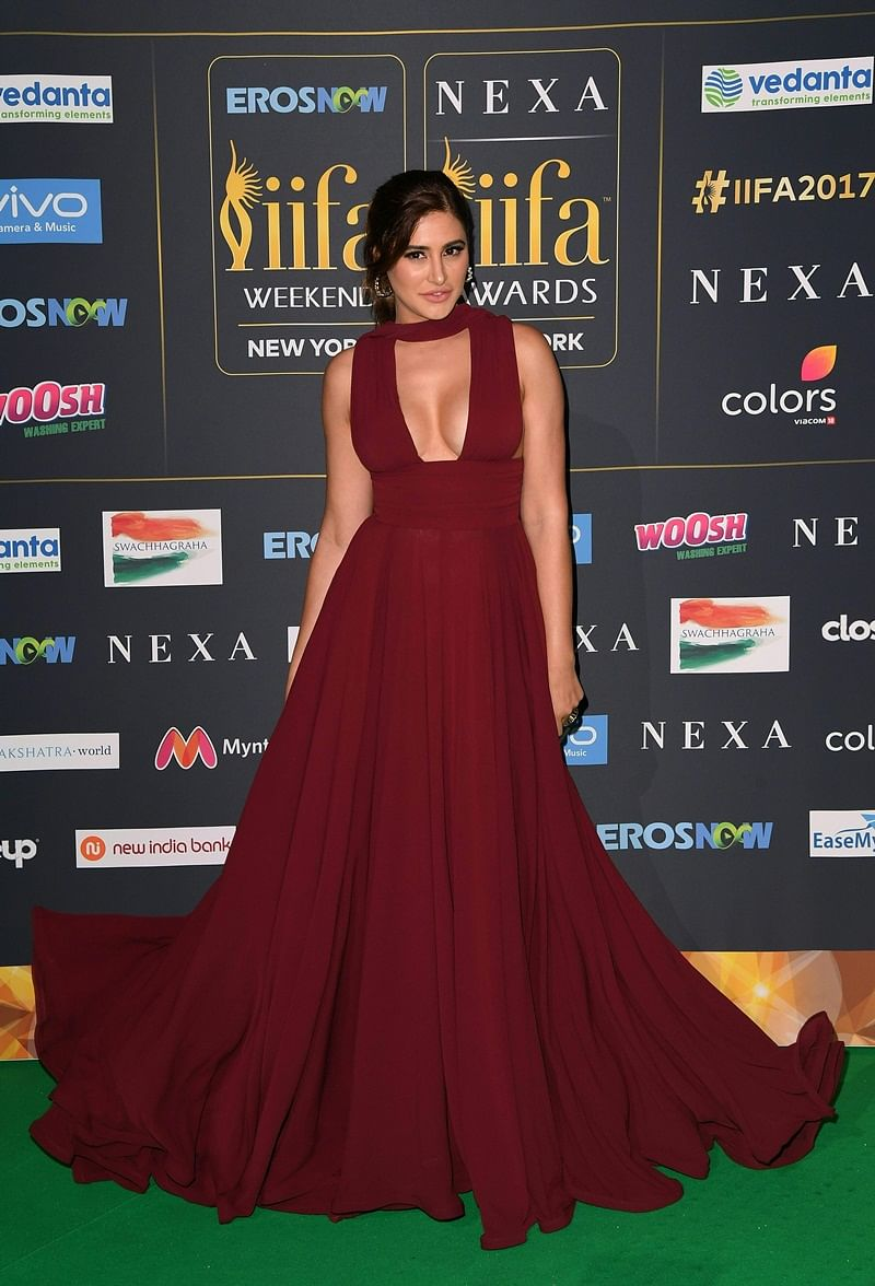 Bollywood Actress Nargis Fakhri arrives for the IIFA Awards July 15, 2017 at the MetLife Stadium in East Rutherford, New Jersey during the 18th International Indian Film Academy (IIFA) Festival. / AFP PHOTO / ANGELA WEISS