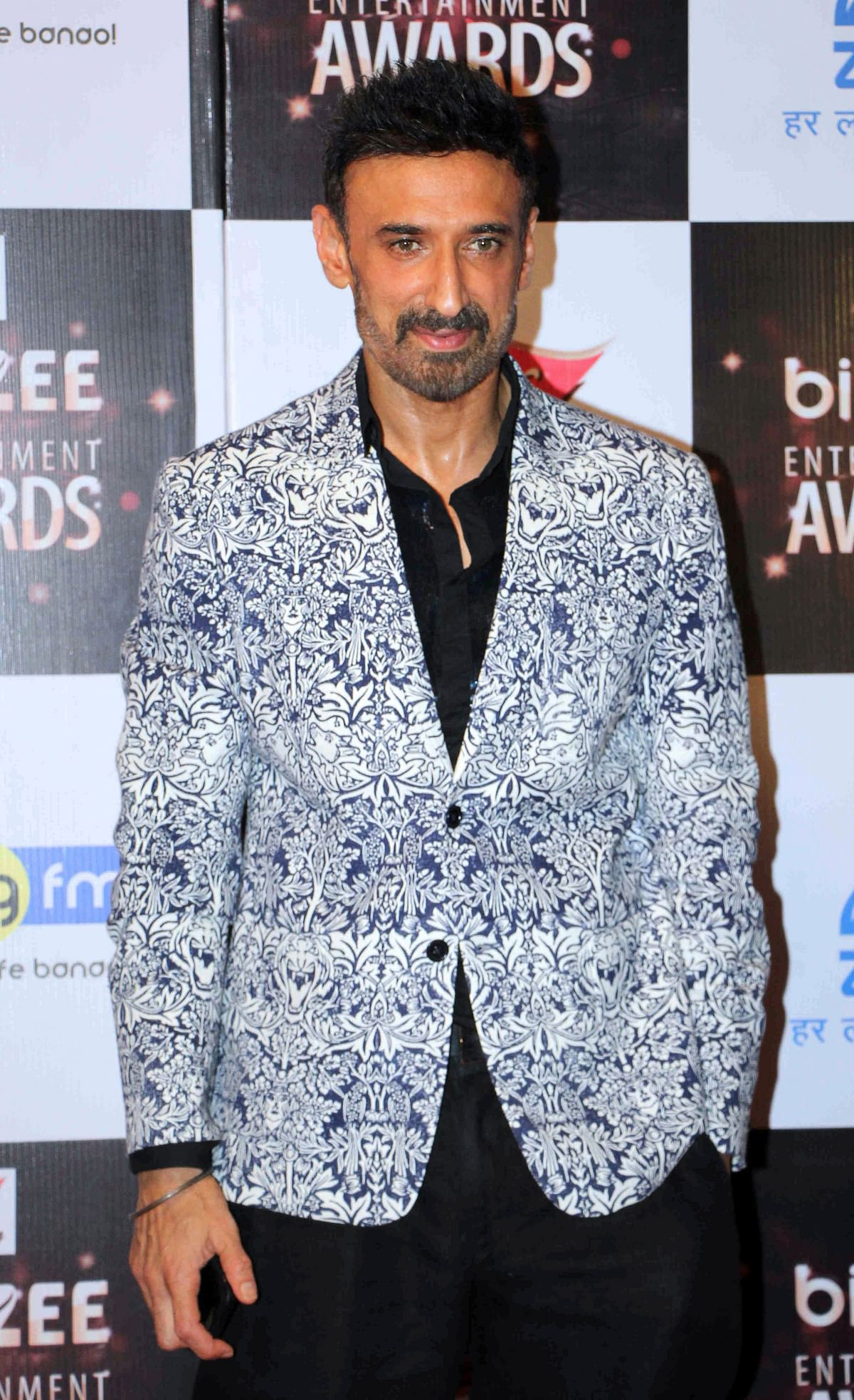 In this photograph taken on July 29, 2017, Indian Bollywood actor Rahul Dev attends the BIG ZEE Entertainment Awards 2017 ceremony in Mumbai. / AFP PHOTO / STR