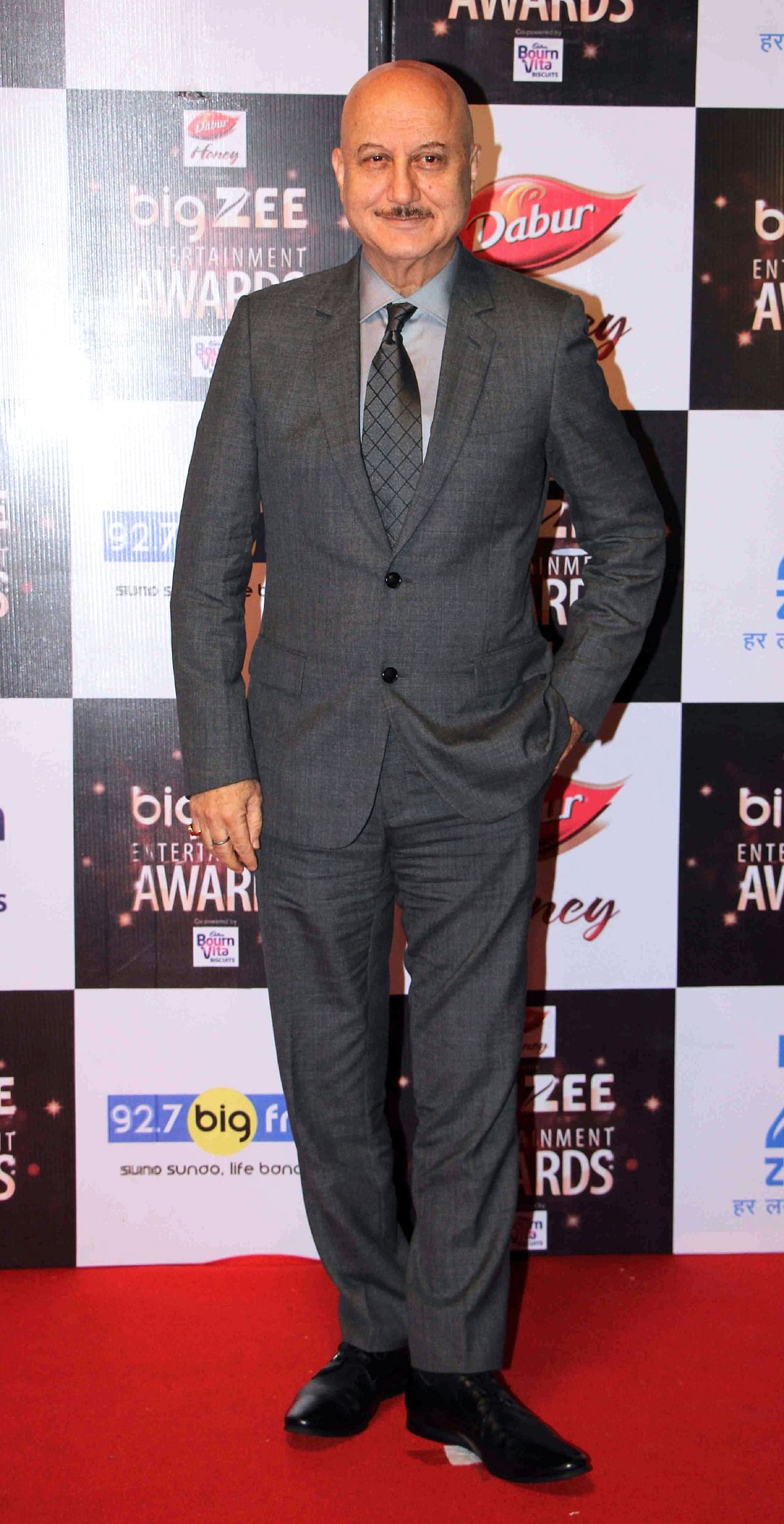 In this photograph taken on July 29, 2017, Indian Bollywood actor Anupam Kher attends the BIG ZEE Entertainment Awards 2017 ceremony in Mumbai. / AFP PHOTO / STR