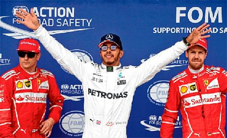 Hamilton storms to British GP pole