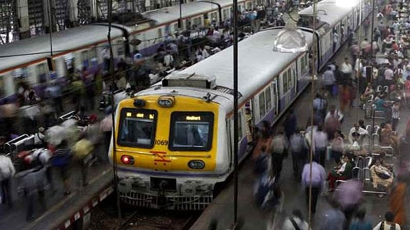 Mumbai: Woman slips under train while trying to board it, RPF official crawls under coach to save her