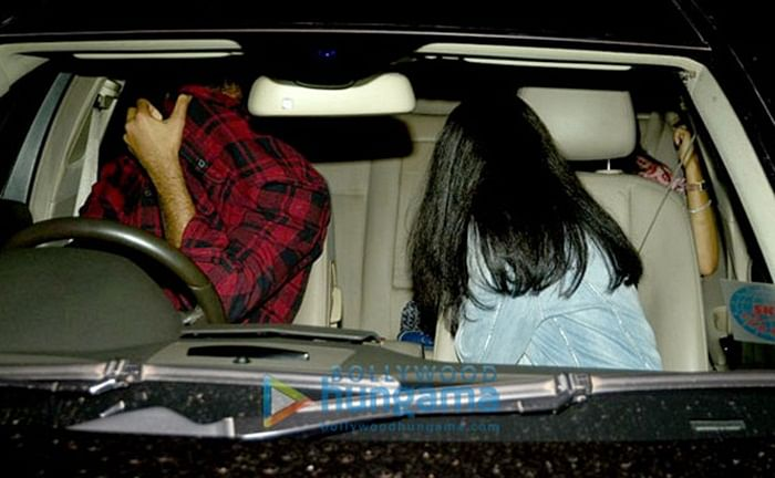 GUESS WHO? The granddaughter of a megastar was hiding her face when paparazzi spotted her with a friend